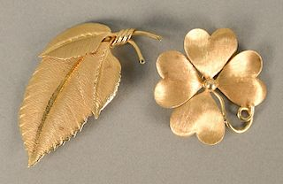 Two 14 karat gold pins, flower and leaf. lg. 2 1/8 in., dia. 1 3/8 in., 13 grams total weight