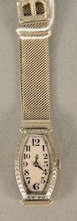 Concord ladies 18 karat white gold wristwatch with adjustable 14 karat white gold mesh band. 19.5 grams total weight