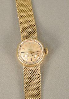 Omega 14 karat gold ladies wristwatch with 14 karat gold mesh bracelet. lg. 6 1/4 in., 25.5 grams total weight