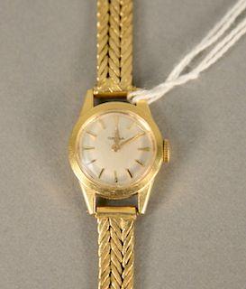 Omega 18 karat gold ladies wristwatch with 18 karat gold bracelet. lg. 6 1/8 in., 24.6 grams total weight