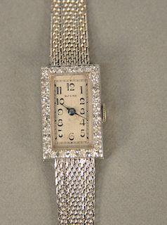 Glycine 18 karat white gold ladies wristwatch with diamond surround. lg. 5 5/8 in., 23.5 grams total weight