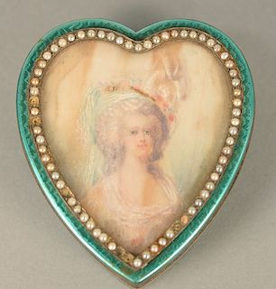 Silver heart shaped box, enameled in green with heart shaped portrait, surrounded by small pearls (6 missing). ht. 1 1/4 in., top: 3...