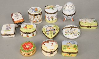 Group of twelve porcelain trinket boxes, 12 days of Christmas, all marked Peint Main Limoges France with painted scenes. tallest ht....