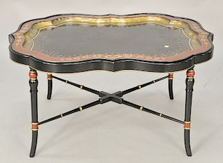 """Regency style tray top low table, shaped oblong top raised on ring turned legs joined by a stretcher. ht. 19 in., top: 29"""" x 38"""" Pro..."""