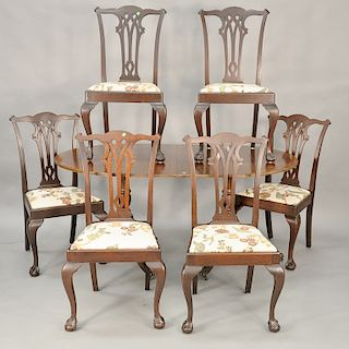 Seven piece dining set to include banded inlaid dining table with one 21 1/2 inch leave and pads along with six Chippendale style si...