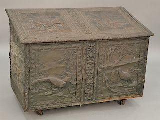 Large copper, wood box with overall embossed copper panels depicting European scenes. ht. 28 1/2 in., wd. 40 in.