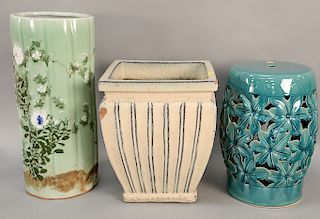 Seven large ceramic pieces to include three garden seats, pair of planters (as is), celadon glazed cane holder (as is), and a large ...