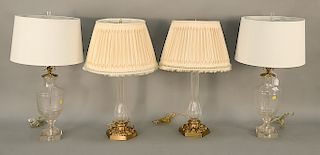 Two pairs of crystal lamps, one in candlestick form and the other in urn form. ht. 30 in. & ht. 28 in. Provenance: From the Estate o...