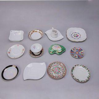 Lote de platos decorativos. México, Alemania, Japón y otros, siglo XX. Elaborados en porcelana acabado brillante. Piezas: 14
