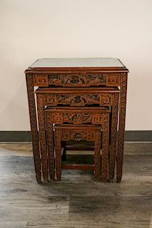 LACQUERED WOOD FOUR-PIECE NESTING TABLES SET, 20TH C.