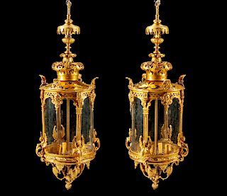 A Pair of Régence Style Gilt Bronze and Glass Lanterns