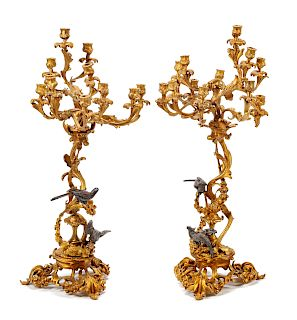 A Pair of Louis XV Style Gilt and Patinated Bronze Twelve-Light Candelabra