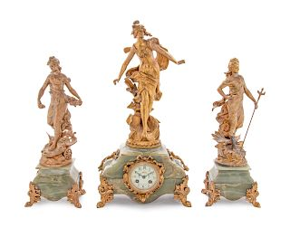 A French Onyx and Gilt Metal Clock Garniture