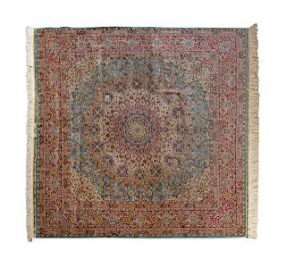 A Persian Silk and Wool Rug
