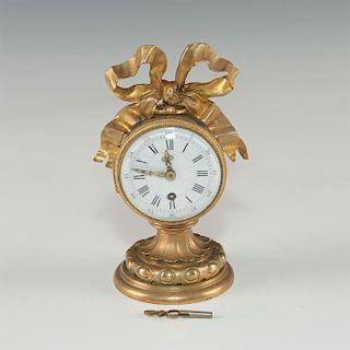 MID-19TH CENTURY SMALL BRONZE MANTLE CLOCK