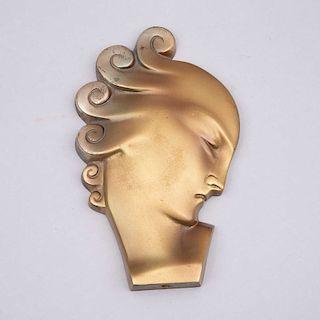 Perfil de dama. Ca. 1930. Estilo Art Decó. Fundición en bronce. 18 cm de altura.