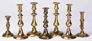 Seven brass candlesticks, etc.