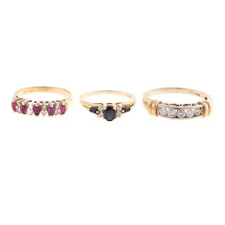 A Trio of Sapphire, Diamond & Ruby Rings in Gold
