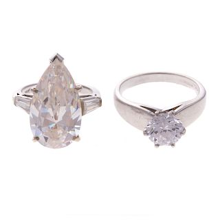 A Pair of CZ Engagement Rings in Gold & Platinum