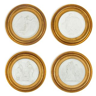 A Group of Four Bisque Plaques <br>each set in a
