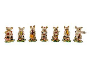 A Porcelain Pig Band<br>comprising 7 musicians.<b