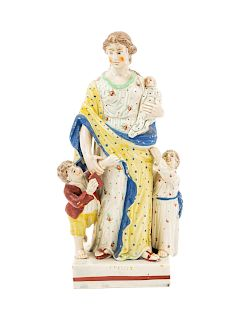 A Staffordshire Pottery Figure of Charity<br>Heig