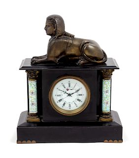 A Mantel Clock<br>decorated with a sphinx.<br>Hei