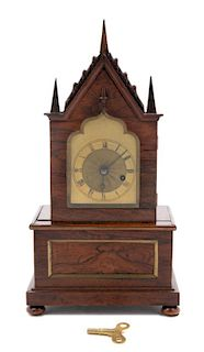 A Gothic Revival Brass Mounted Mantel Clock<br>LA