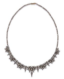 A Silver Topped Yellow Gold and Diamond Necklace,