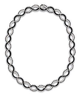 An 18 Karat White Gold, Diamond, Black Diamond, Rock Crystal and Onyx Necklace,