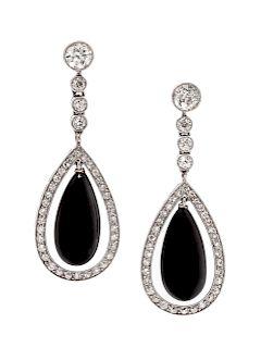 A Pair of Platinum, Diamond and Onyx Pendant Earrings,