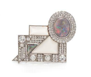 An Art Deco Platinum, Opal, Diamond and Rock Crystal Brooch,