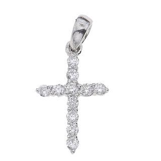 Cruz con diamantes en oro blanco de 14k. 11 diamantes corte brillante. Claridad SI1. Color H-I. 0.11ct. Peso: 0.6 g.