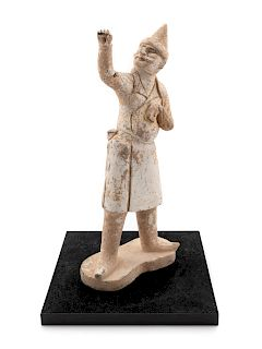 A Pottery Figure of a Groom Height 15 1/2 in., 39 cm.
