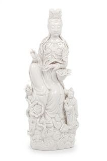 A Blanc-de-Chine Porcelain Figure of Guanyin Height 12 1/2 in., 32 cm.