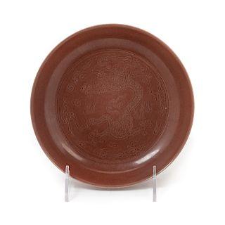 A Cafe-Au-Lait Glazed Porcelain 'Dragon' Plate Diam 7 in., 18 cm.