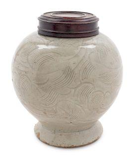 A Celadon Glazed Porcelain Incised Jar Height 4 3/4 in., 12 cm
