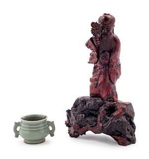A Small Celadon Glazed Porcelain Incense Burner Figure: height 10 1/2 in., 27 cm. Incense burner: height 1 7/8 x diam 2 1/8 in., 5 x 5 cm.