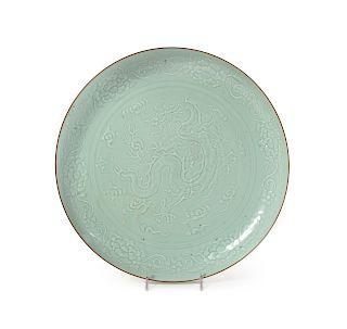 A Large Carved Celadon Glazed Porcelain Charger Diam 16 in., 41 cm.