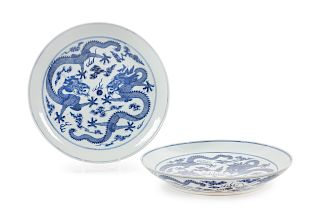 A Pair of Blue and White Porcelain 'Dragon' Plates Diam 15 1/8 in., 38 cm.