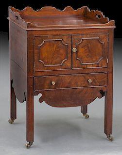 Georgian mahogany bedside cabinet with shaped