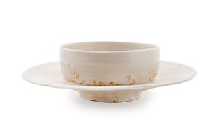A ChineseDingyao White Glazed Porcelain Cup and Stand Diam 6 in., 15 cm.