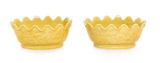 A Pair of Chinese Yellow Glazed Porcelain Floriform Plates Each: length 7 1/4 in., 18.4 cm.