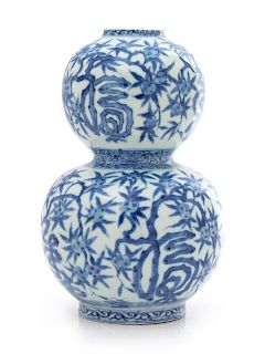 A Chinese Blue and White Gourd-Form Porcelain Vase Height 7 7/8 in., 45 cm.