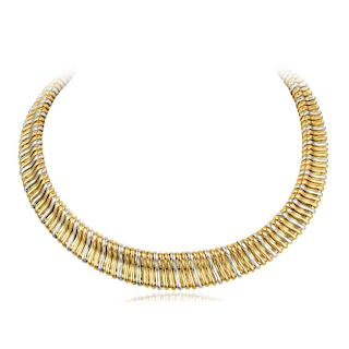 A Yellow and White Gold Omega Necklace