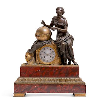 A French  bronze and rouge marble mantel clock