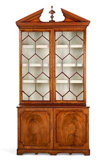 A George III yewwood inlaid mahogany bookcase