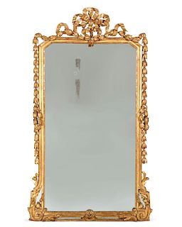 A Louis XVI style carved giltwood mirror