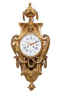 A Louis XVI style gilt bronze cartel clock