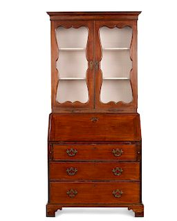 A George II walnut secretary bookcase